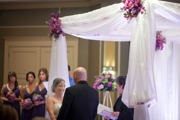 A Chuppah decorated with graceful flowing organza fabric at Harry's Savoy Ballroom.