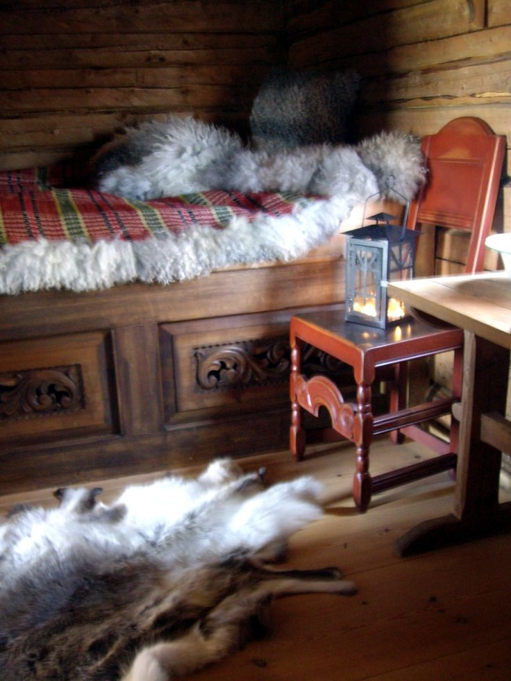A Norwegian tradition is the use of sheepskin. Some times it is made with a (aakle) Skillbragd coverlet woven in a twill diamond overshot pattern using homespun and dyed wool. http://roarpels.no/