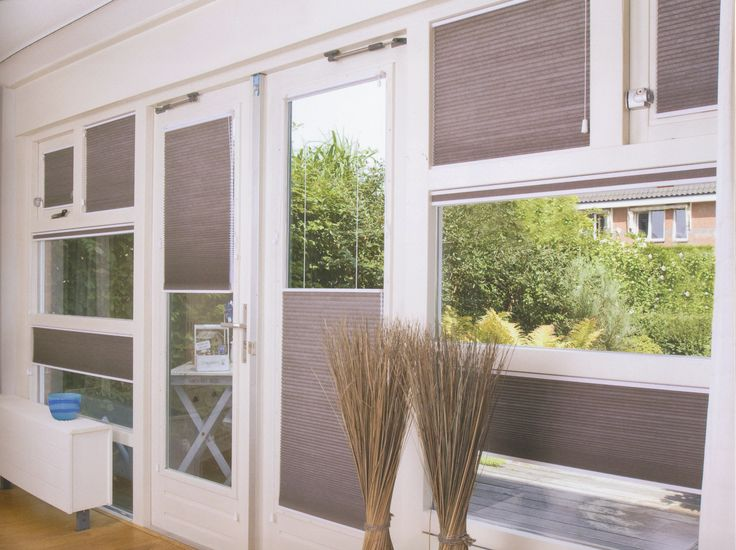 Choose cordless shades for a clean look in rooms with many windows. Find these Norman Cellular Shades at Blinds.com