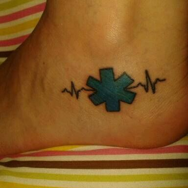 This is my EMS tattoo! :) Done on July 11th. Woot woot!