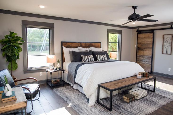 In the amended design plan, a small adjacent bedroom was sacrificed to create one large master suite with a much larger footprint. The old carpet and popcorn ceiling were removed, and new hardwood floors added as well as enlarged windows.