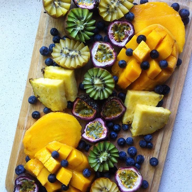 fruit platter: mango, pineapple, passionfruit, kiwifruit & blueberries