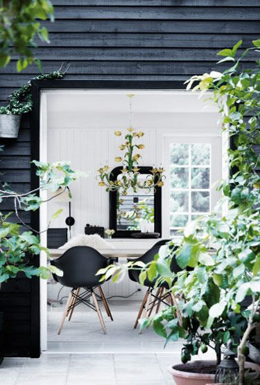 Beautiful Danish Summerhouse, love the contrast of the black exterior with the white internal timbers