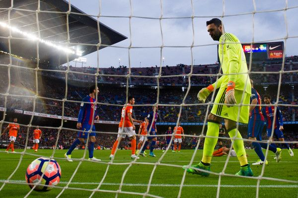 Salvatore Sirigu of CA Osasuna looks on as Andre Gomes of FC Barcelona scores his sides second goal during the La Liga match between FC Barcelona and CA Osasuna at Camp Nou stadium on April 26, 2017 in Barcelona, Catalonia.