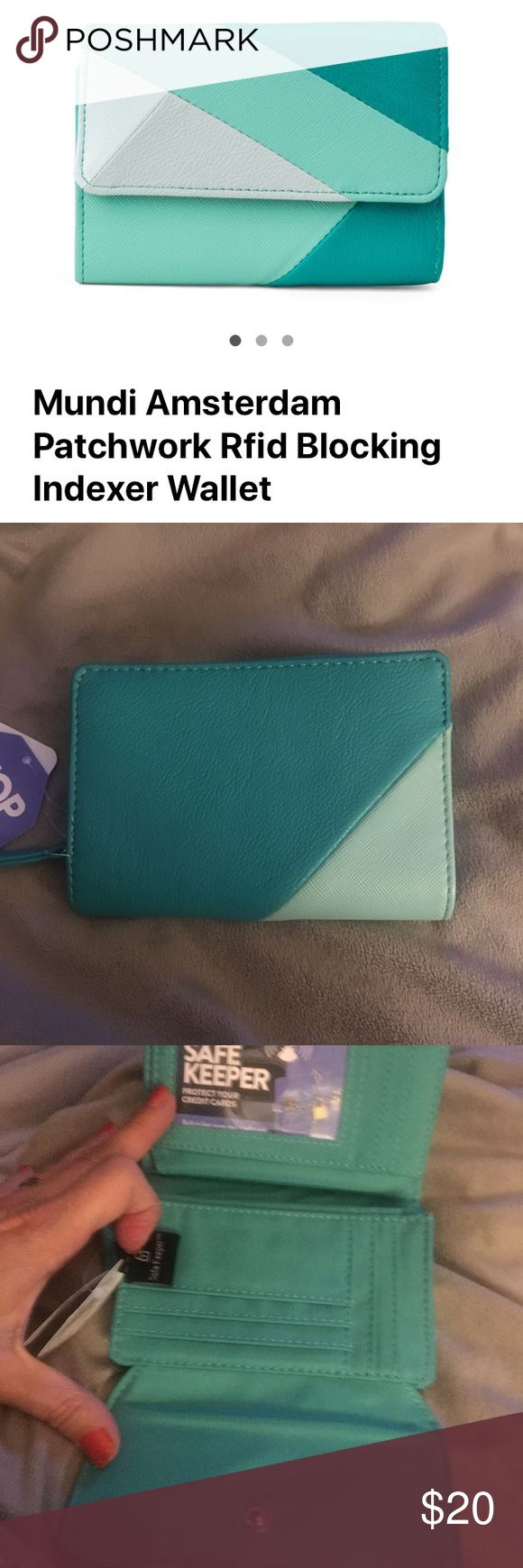 Mundi Identity thief safe keepers wallet This Beautiful aqua patchwork wallet is brand new. Original price $35. See description above. Mundi Bags Clutches & Wristlets