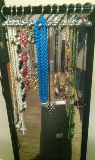 reuse old shower curtain hangers for necklaces !!! saves space and is very cute!