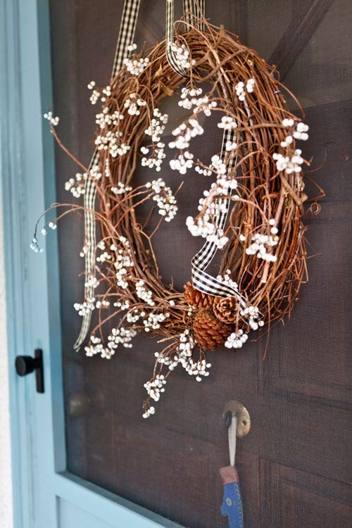 Homeowner says: I made this winter wreath for our front door with tallow berry branches, pinecones, and some vintage ribbon.