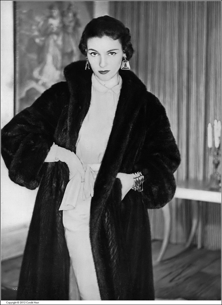 Model in Great Lakes mink greatcoat from Paul Kossoff, greige linen-rayon sheath by B.H.Wragge, Bergère link bracelet, Napier earrings, photo by Clifford Coffin, Vogue, December 1952