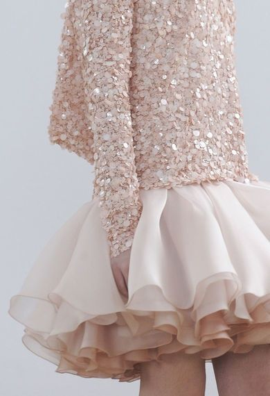 not crazy about the sequin sweater, but the skirt!!