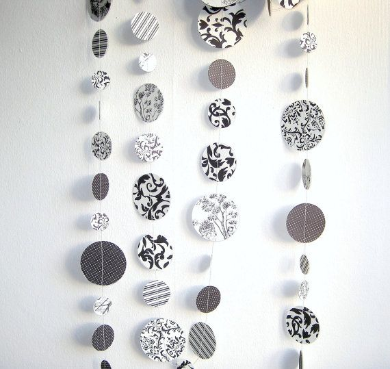 DIY...Looks like it could be fishing line & scrapbook circles