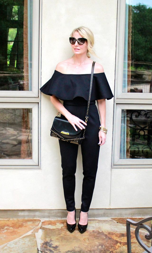 Erin from Busbee Style in an off-th-shoulder jumpsuit.