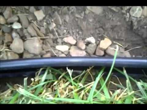 How to install Plastic Landscape Edging around a planting bed. Add stakes periodically to the edging to prevent movement due to freeze & thaw & settling of d...