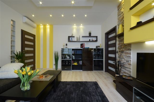 design by Xenia Studio living room yellow, colorful
