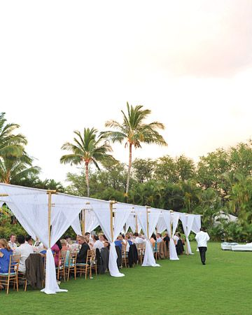 Guests dined under a canopy of white gossamer at this @Four Seasons Resorts Lanai outdoor reception.