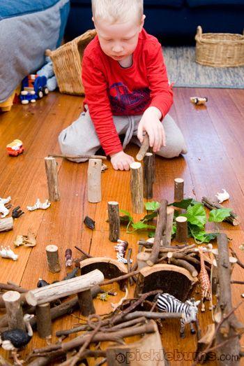 home made wood blocks, sticks, plastic animals...