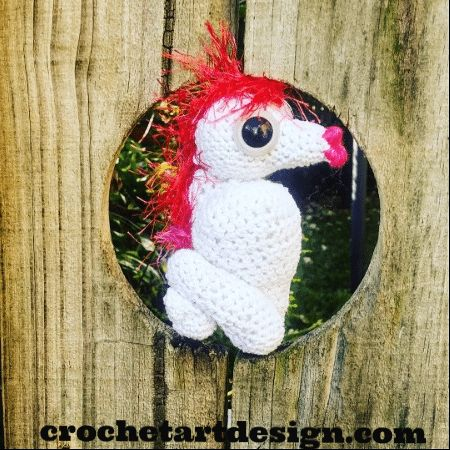 Crochet Seahorse      Crochet Materials:    Crochet hook size 2.5    Crochet yarn: 100 % cotton white, 100 % acrylic pink, 100 % acrylic feather red yarn.    Sewing needle.    Scissors.    Craft eyes.    Craft stuffing.  Crochet stitches  Chains (ch)    Slip stitch (sl st)    Single crochet (sc)  Crochet Seahorse head.  This pattern uses US stitch