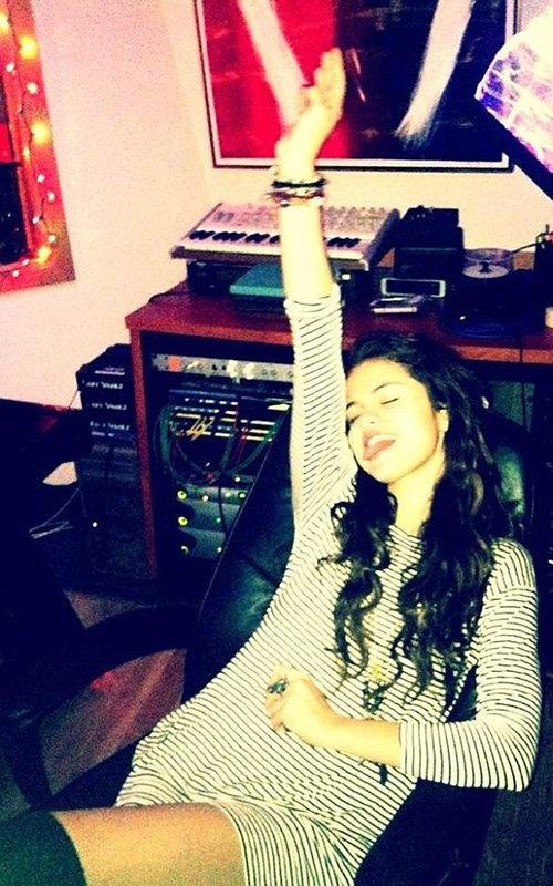 Selena Gomez rocking #moreismore bracelets