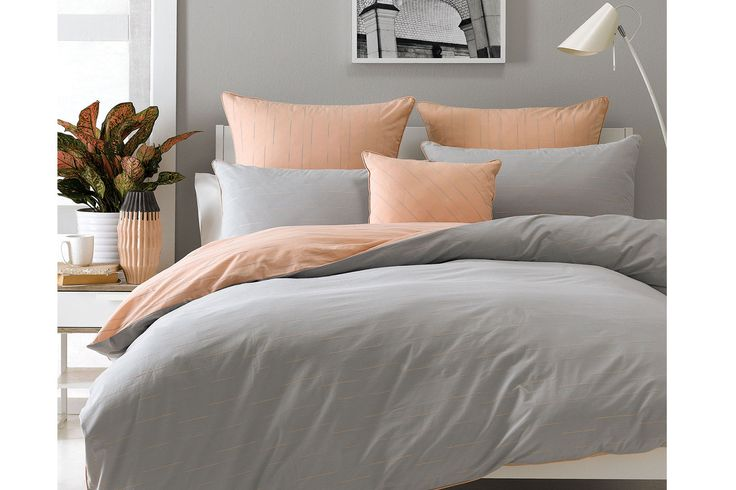 Fully reversible and woven on yarn dyed cotton, the Beck Peach Duvet Cover Set by Nu Edition features a beautifully textured charcoal-style stripe on a solid coloured background. Choose between a neutral base colour with pops of brightly coloured stripes, or reverse over to the bright base colour with neutral stripes.