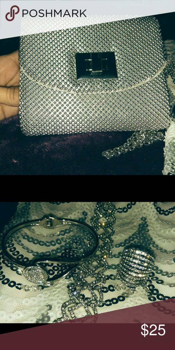 Clutch and accessories *****BUNDLE WITH GIANNI BIN AND MIDNIGHT DOLL DRESS IN MY CLOSET FOR AN AMAZING DISCOUNT!!*******  Silver Clutch with 2 beautiful Sterling silver bracelets and a beautiful sterling silver ring! Believe the ring is size 7!! Go perfect with the Gianni Binis and Midnight Doll Dress in my closet!! Charming Charlie Bags Clutches & Wristlets