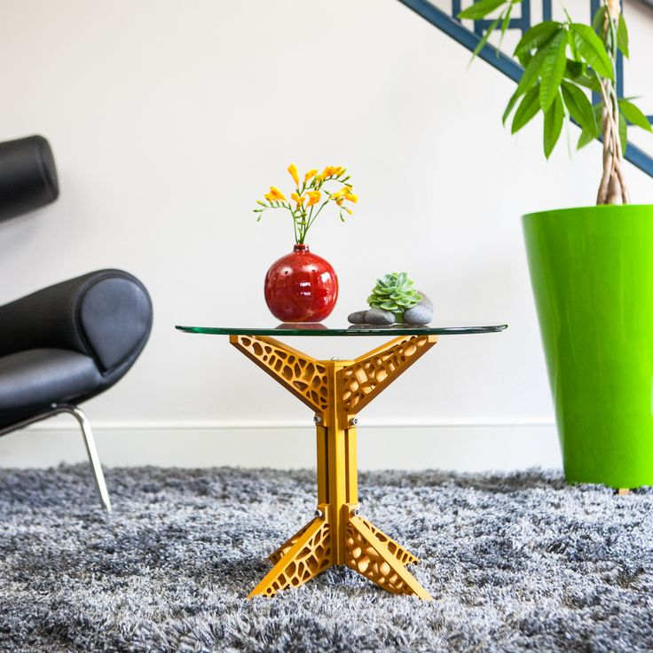 Craft-Modern's GiraTable- gold post and table legs with glass top