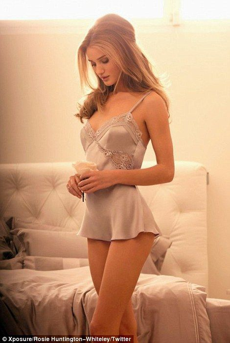 Rosie, who is a collector of vintage lingerie, models the grey silk teddy from the collection