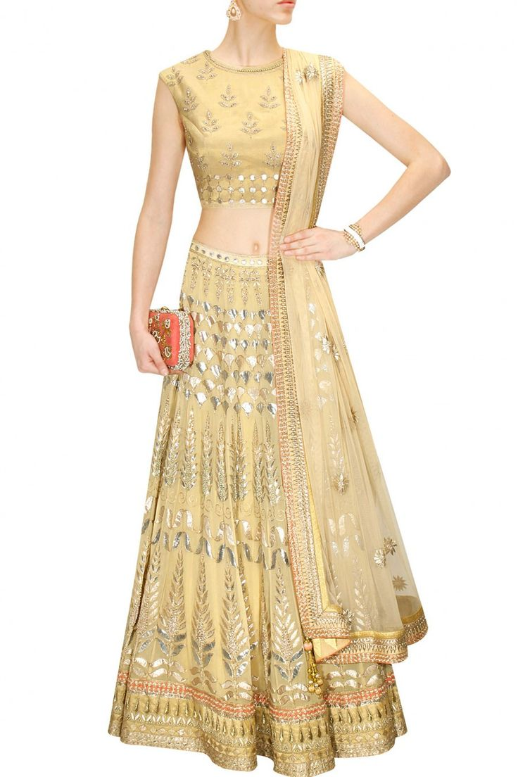 This Golden color Bridal Lehenga Choli is featuring in georgette fabric embellished with traditional gota patti embroidery.  This Golden color Bridal Lehenga Ch