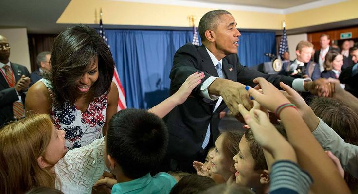 President Barack Obama and first lady Michelle Obama greet children and families of embassy personnel at Melia Habana Hotel, in Havana, Cuba, on Sunday. (AP)