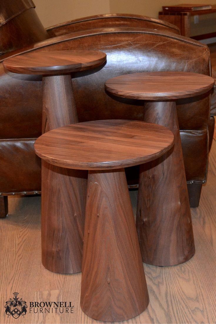 """Set of three pedestal tables in walnut. 18"""" tall x 13"""" diameter, 21"""" tall x 12"""" diameter, 23"""" tall x 11"""" diameter."""