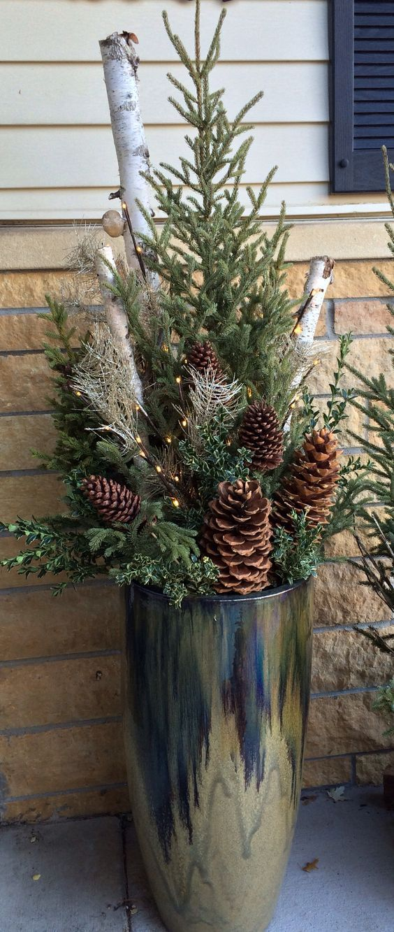 Love the metal planter with winter decor... might try this for the front steps this winter