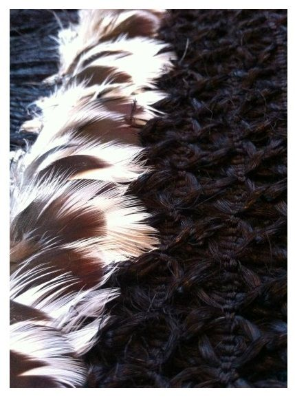 Kereru feathers on black muka mawhitiwhiti by Veranoa Hetet. The weaving was completed in 2012. It took Veranoa six years to complete and was started by her mother Erenora Puketapu-Hetet just before her passing in 2006.