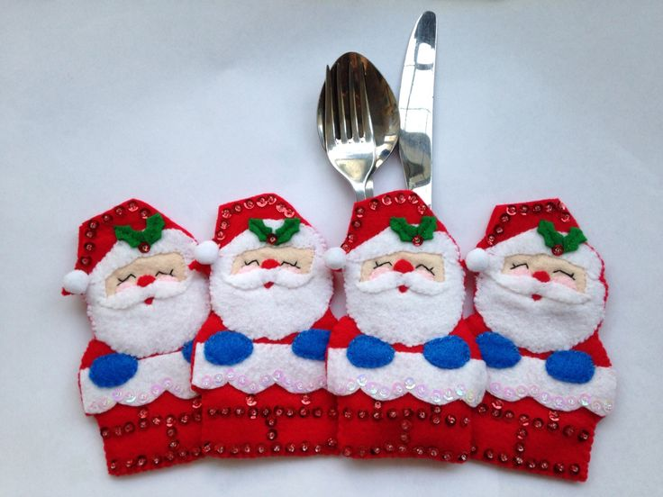 Add a little fun to the festive season with a set of four novelty sparkly Christmas cutlery holders shaped as Father Christmas.  Perfect for all ages to bring a bit of festive fun to the Christmas table.   Dimensions: 13cm x 8cm (Height x Width) - Santa  Most standard sized cutlery should fit into this design.