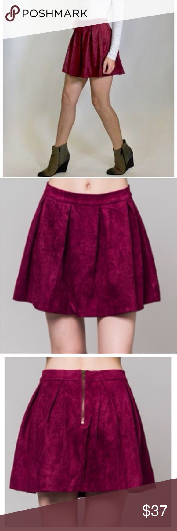 Jackie's Pleated Suede Skirt Every girl needs a sublimely soft faux suede skirt for the fall season, and this skirt is just right. Burgandy color  Faux Suede Skirt Pleated Skater Skirt Waistband with Exposed Back Zipper 100% Polyester REASONABLE offers are welcome. Bundles of 1 will be IGNORED. ❌ ❌Sorry no trades. Honey Punch Skirts Mini