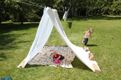Clothesline tents. (clothes pins, line, old blankets, bricks)  We used to play for hours in them.  We even slept outside by ourselves.