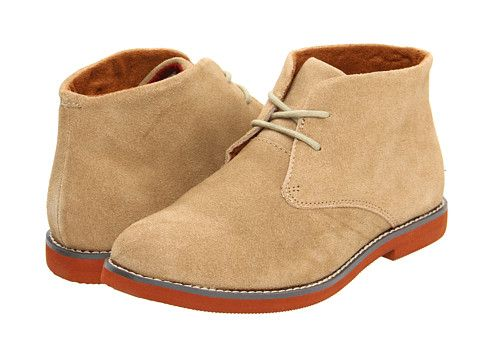 Tan boots with orange soles