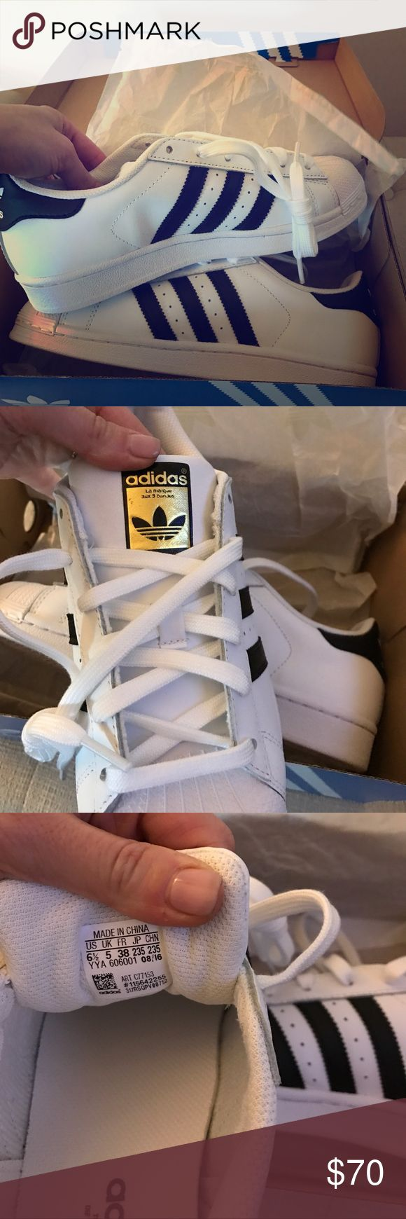 Adidas Brand new! Never worn. Still in box. Given as a gift and they are too big. Purchased for $79.99. More expensive than the original because of the gold logo on tongue of shoe. You can compare to prices online and in stores. Adidas Shoes Athletic Shoes