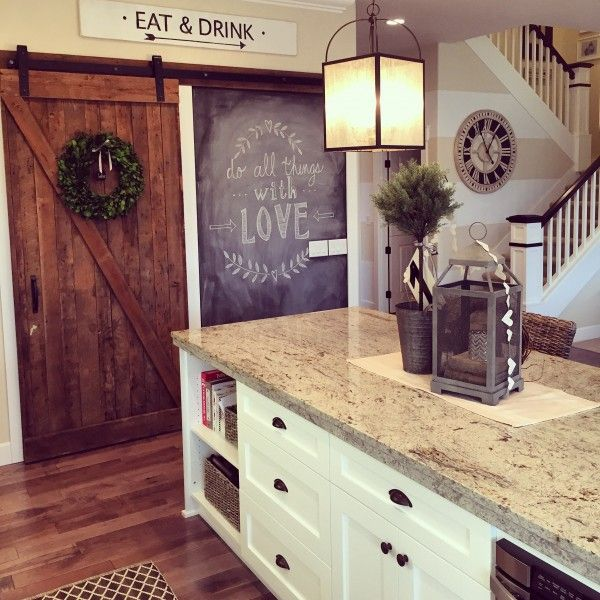 Eclectic Home Tour of Yellow Prairie Interiors - love the rolling barn door and chalkboard wall in this gorgeous white kitchen eclecticallyvintage.com