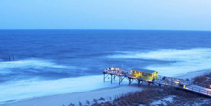 OCEAN GRILL AND TIKI BAR: CAROLINA BEACH, NC  Love this place!  Especially at night right at sunset!