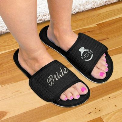 Pamper the bride with embroidered slippers.  See more bridal shower gift ideas at www.one-stop-party-ideas.com