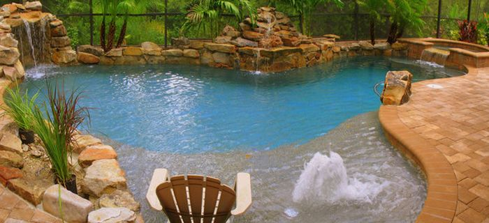 LANDSCAPING:  Literally the perfect pool, with shallow / wading end for keeping your feet wet while sitting.