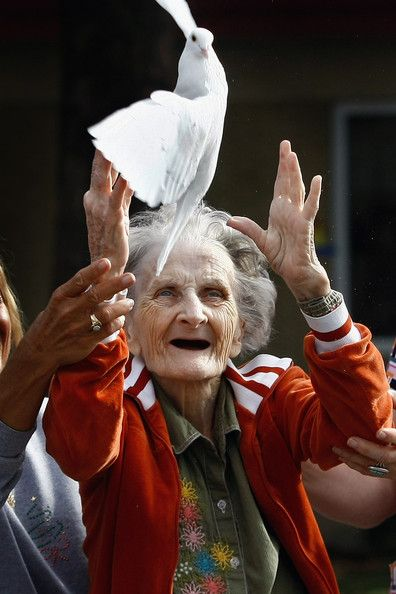 Terminally ill patient Jackie Beattie, 83, releases a dove on October 7, 2009 while at the Hospice of Saint John in Lakewood, Colorado. The dove releases are part of an animal therapy program designed to increase happiness, decrease loneliness and calm terminally ill patients during the last stage of life.