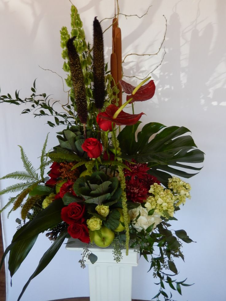 A stunningly impressive Lobby arrangement in luxurious deep reds and greens done for a Toronto corporate law firm by Dizennio Floral Boutique. This is an example of a weekly arrangement we do for several companies