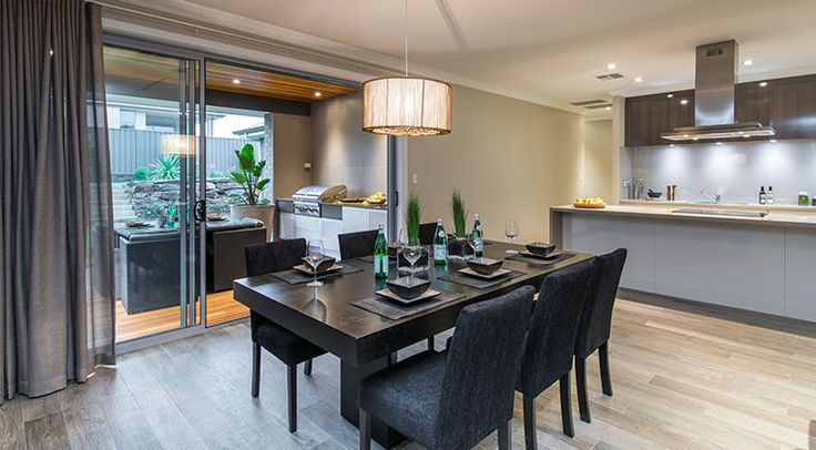 The open plan style of the kitchen, dining and alfresco area give this home a well connected feeling. #openplan #dining #kitchen #alfresco