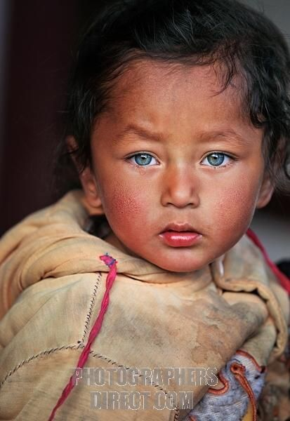 Portrait of a Nepali child with amazing eyes in the hills ...