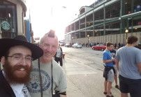 Waiting for a friend outside Wrigley Field, Paul Schneider discovers a new way to honor an ancient ritual.