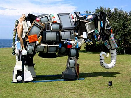 """Anthony Heywood's sculpture """"Broken Family"""" which is made out of TV's and other household products"""