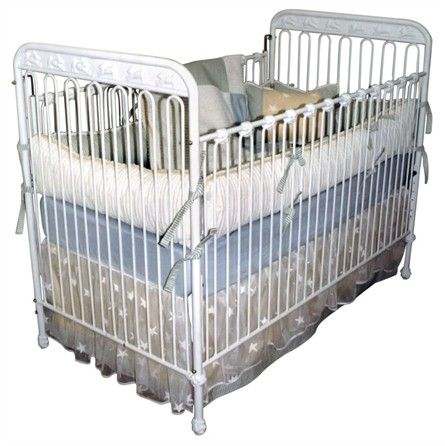 Engraved bunnies decorate this hand forged iron crib by Corsican. Made by skilled craftsmen who uphold a tradition of handcrafted beauty, attention to detail and a commitment to quality