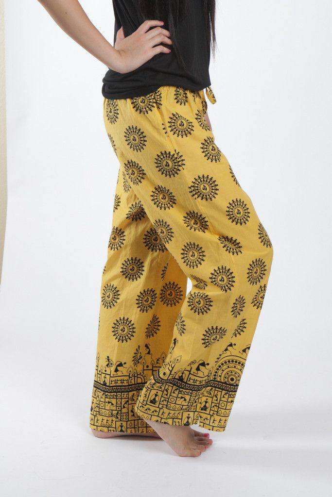 Sunny yellow cotton with hieroglyphic-inspired images dancing around in circles. #punjammies