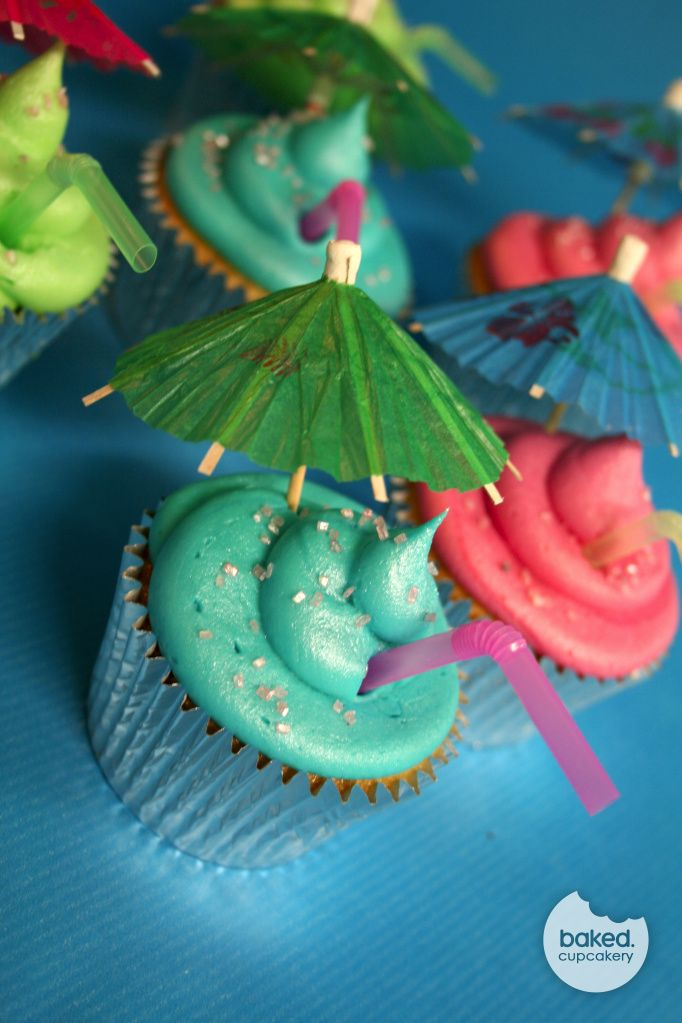 Cocktail themed cupcakes complete with straws and umbrellas