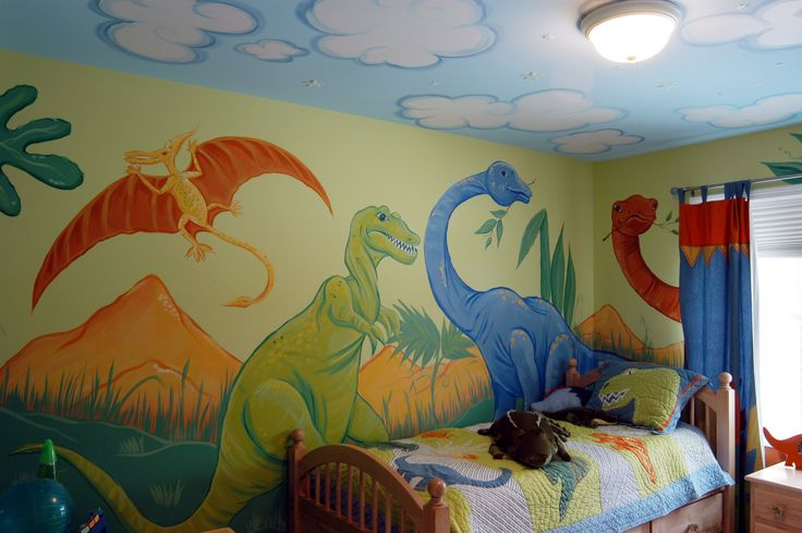 A friendly dinosaur mural and cloud ceiling to compliment the company Kids bedding and curtains.