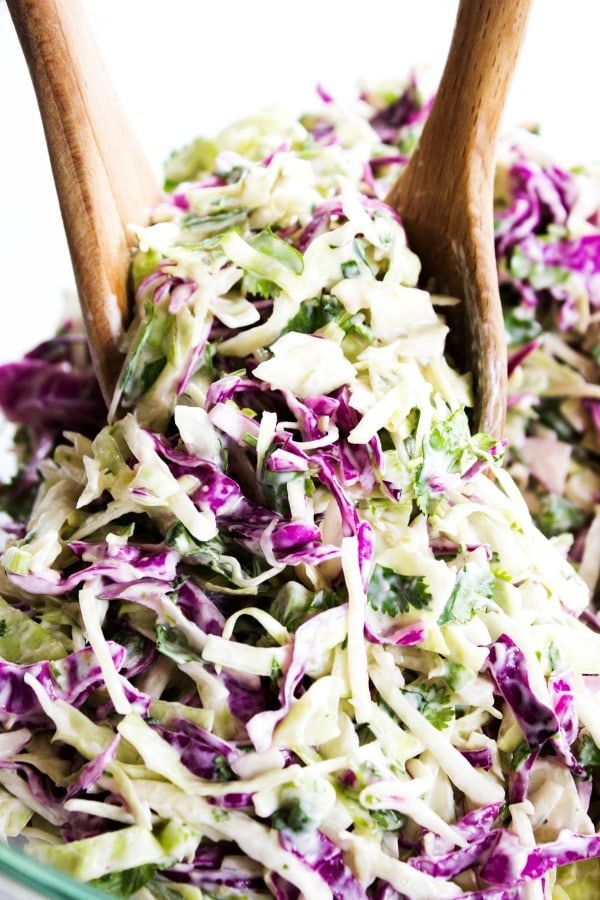 A savory coleslaw made with red and green cabbage, cilantro, green onion and limes proves that cabbage can be the star of any meal.